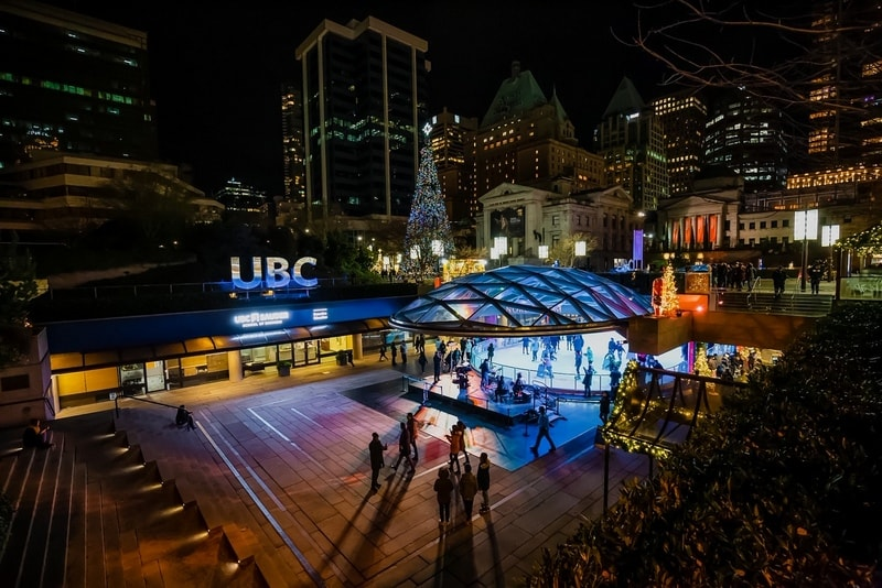Downtown Vancouver, British Columbia, Canada - December 31, 2018: Crowd of people are ice skating in Robson Square during New Year's Eve.