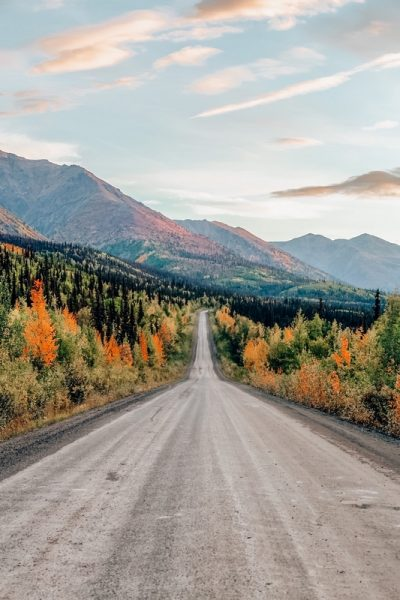View of Scenic Road Leading to Tombstone and Mountains in Canadian Nature. Dempster Highway, Yukon, Canada.