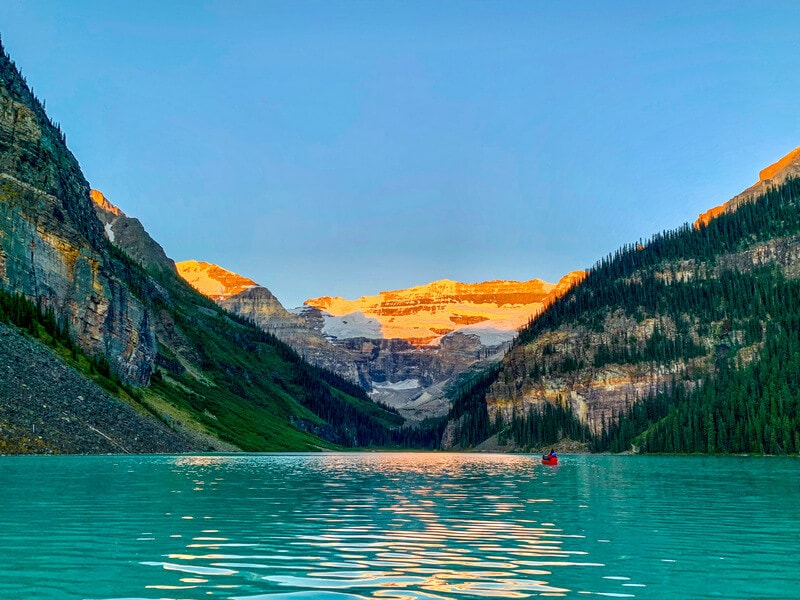 Lake Louise canoeing in the summer months. Learn how to move to Canada on a working visa