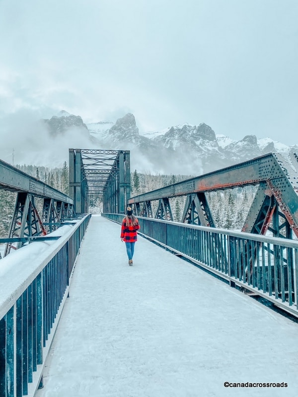 Girl in Canmore Engine Bridge - Things to do in Canmore in winter